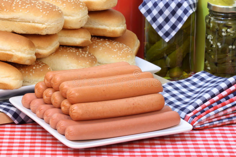 Hot dogs. Hot dog ingredients on a nice table setting rich in colors and flavors royalty free stock photo