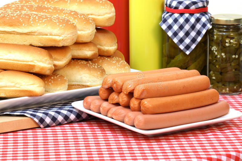 Hot dogs. Hot dog ingredients on a nice table setting rich in colors and flavors stock photos
