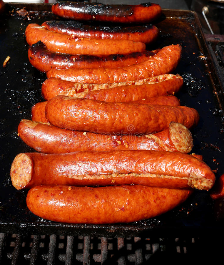 Hot dogs cooking royalty free stock photos