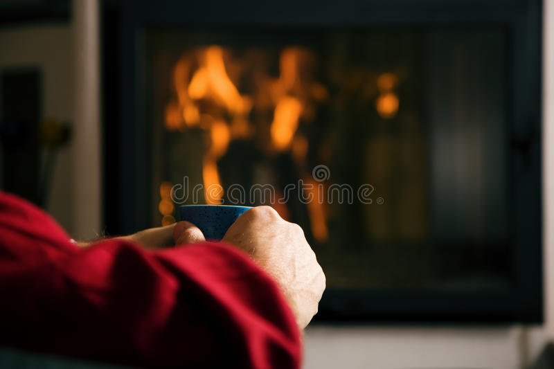 Download Hot Drink In Front Of Fireplace Stock Image - Image: 12409245