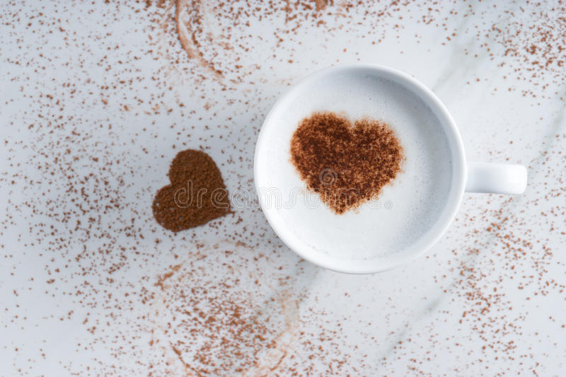Hot drink with heart shape cocoa stock image