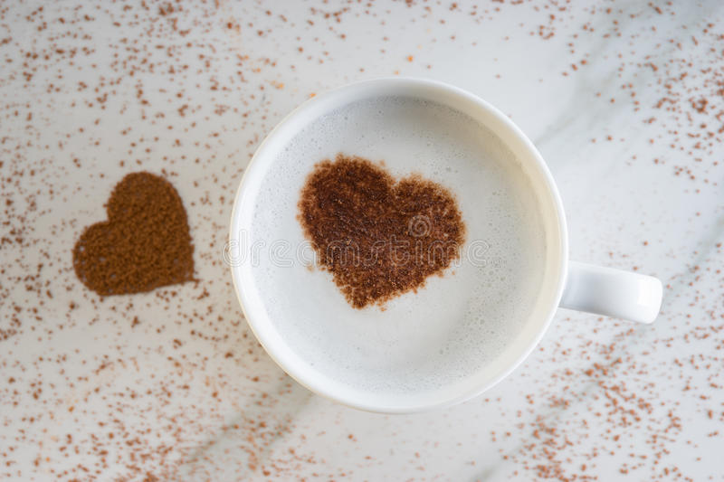 Hot drink with heart shape cocoa royalty free stock images