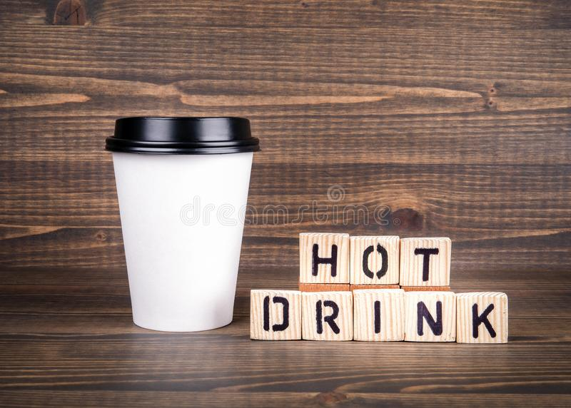 Hot Drink, wooden letters on desk. Coffee cup with copy space stock photography