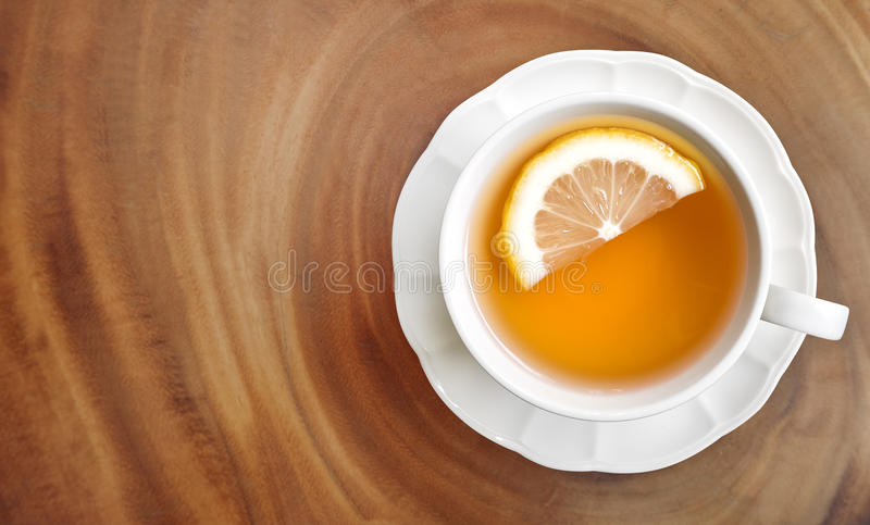 Hot earl grey tea with lemon slice top view on wood table background royalty free stock photography