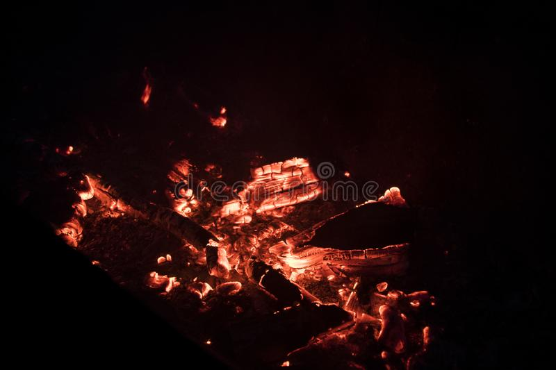 Hot embers from a campfire at night. Fire at night. Hot embers from a campfire at night. Can be used for background and texture. Fire at night. Fire red and royalty free stock images