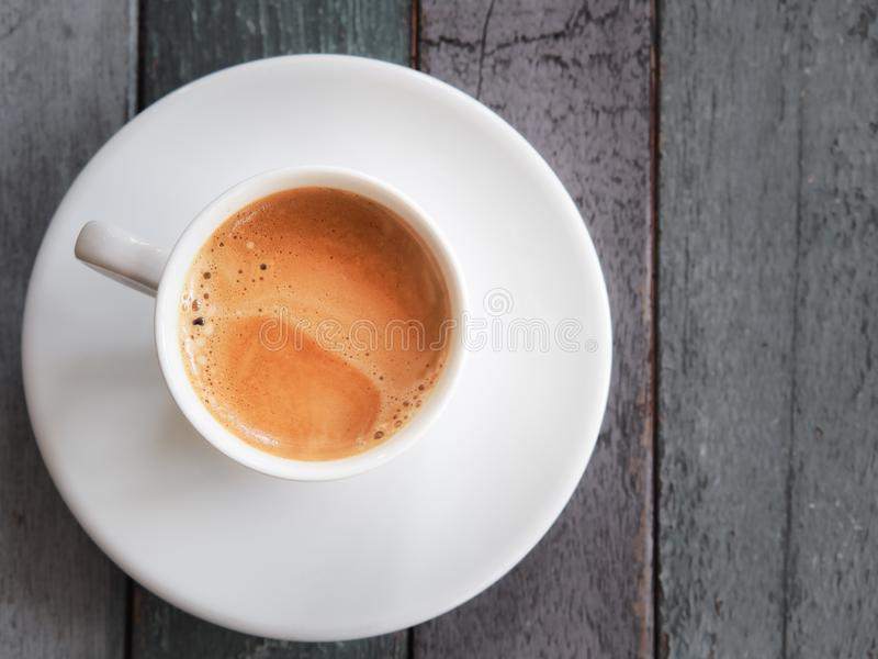 Hot espresso coffee cup on wooden table. Fresh hot Coffee by top view royalty free stock photography
