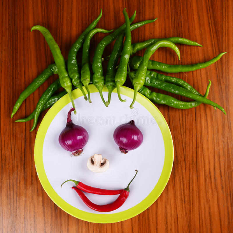 Hot Face. Smiling face from fresh Vegetables