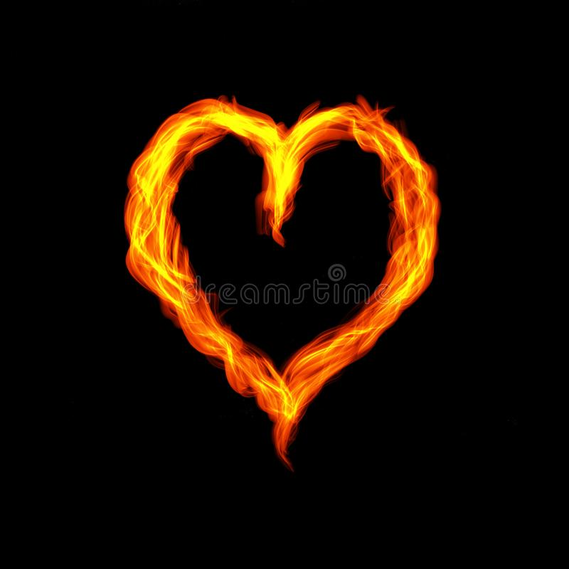 Hot fire heart burning on black background. Passion and desire stock image
