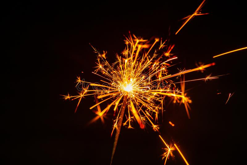 Hot fire sparks explosive fuse and flash. From welding isolated on black stock images