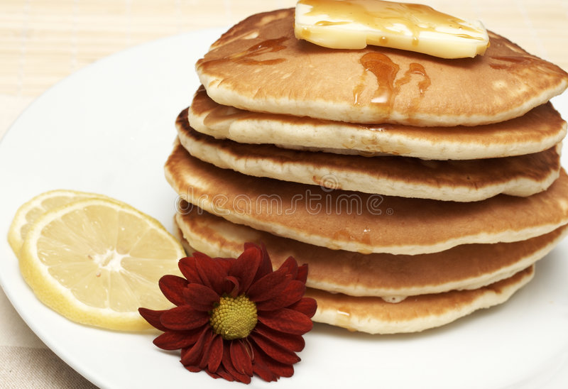 Hot flapjacks with syrup stock photos