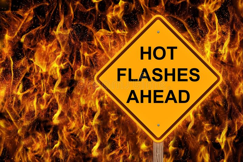 Hot Flashes Ahead Warning In Flames. Hot Flashes Caution Sign Against A Flaming Background royalty free stock photos