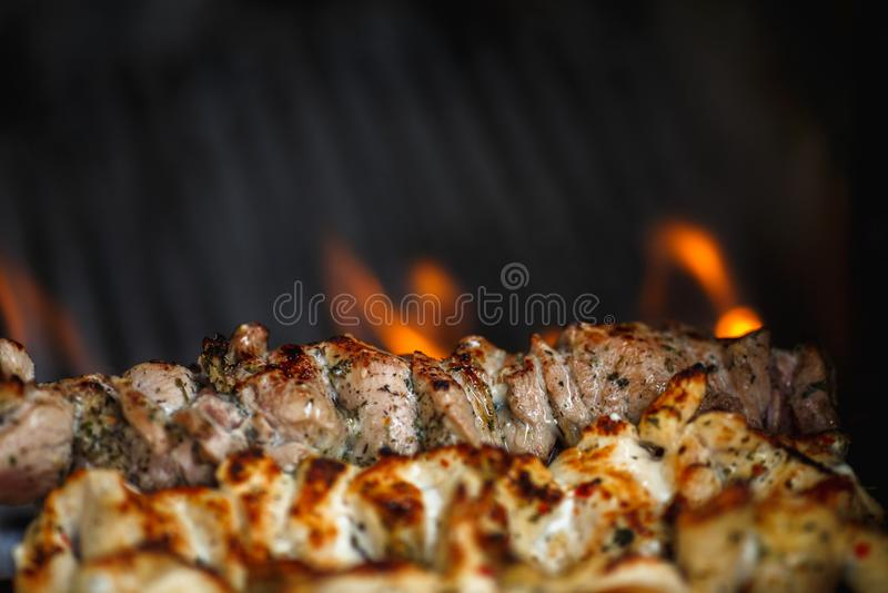 Hot flavorful meat barbecue, shashlik, kebab, skewer on the grill. Hot flavorful meat barbecue, shashlik, kebab, skewer close up on the grill stock images