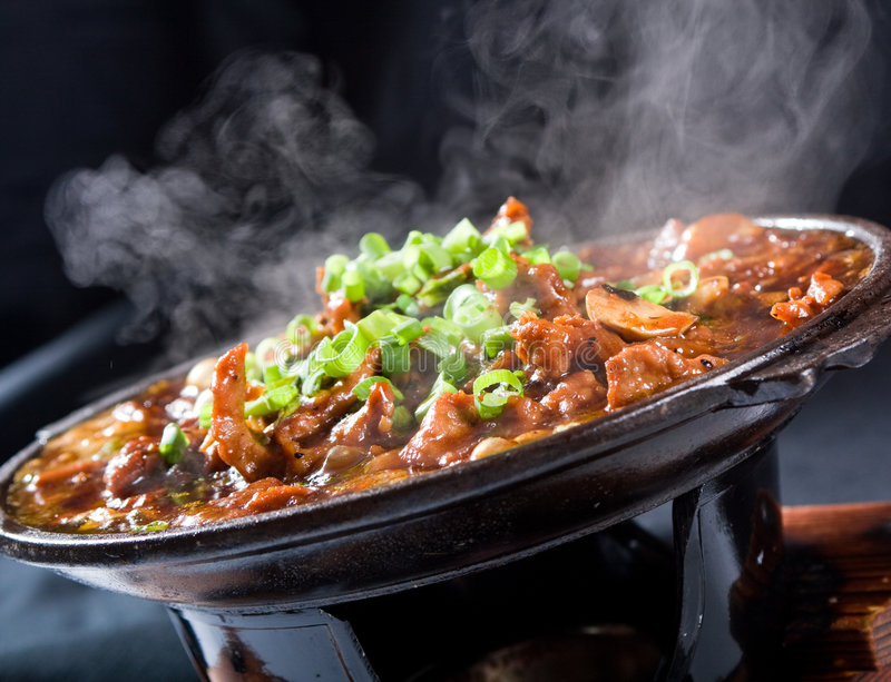 Hot food. Steaming hot chinese meat food royalty free stock images