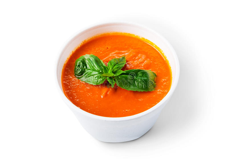 Hot food delivery - tomato gazpacho soup isolated. Spanish cuisine hot food delivery - tomato diet cream soup gazpacho isolated at white closeup in white plastic stock images