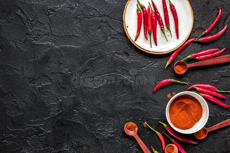 Hot food with red chili pepper dark table background top view mo stock image