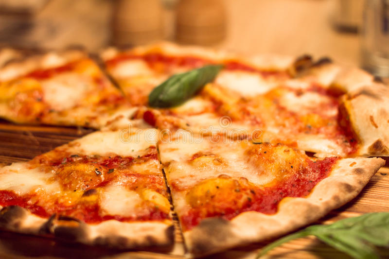 Hot fresh delicious pizza Margherita. DOF. royalty free stock image