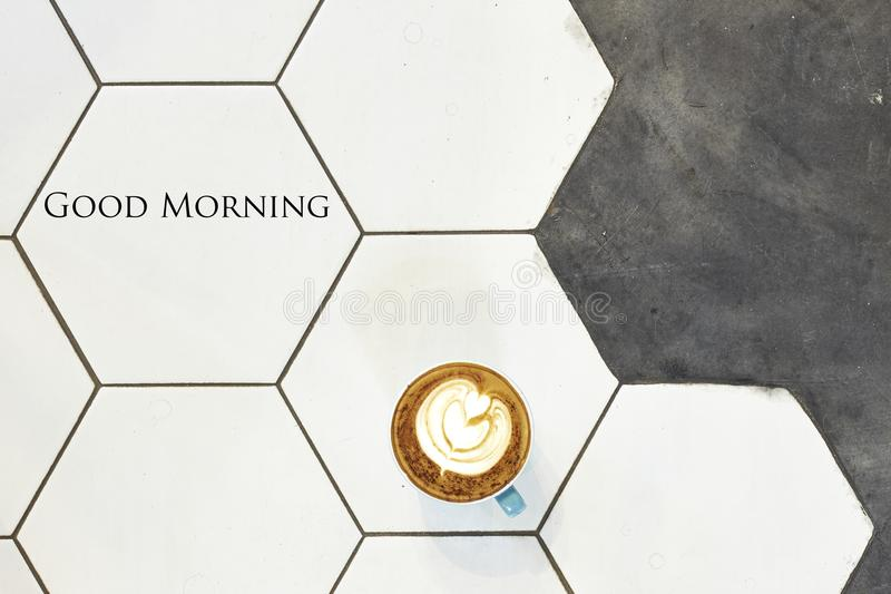 Concept minimal Coffee, good morning. Hot fresh latte coffee cup on white ceramic tiles overhead view.Flat lay.Top view with copy space,good morning stock photos