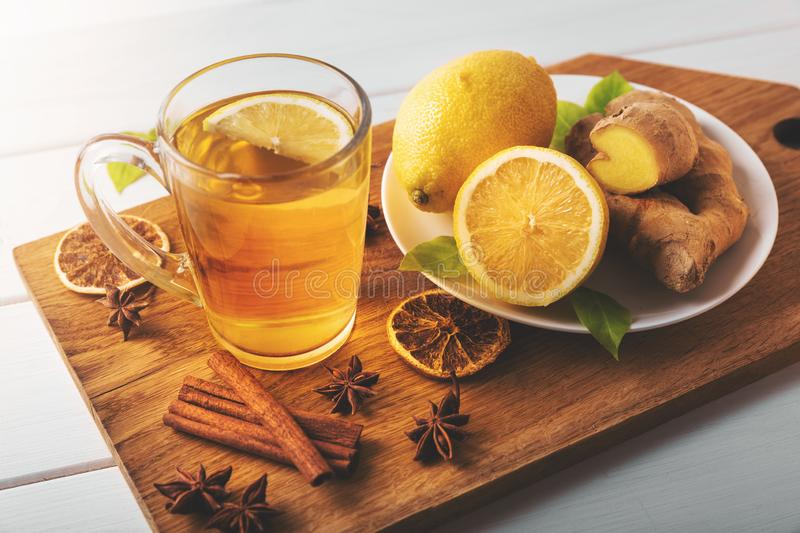 Hot ginger tea with lemon. flu cold season drink. Hot ginger root tea with lemon. flu cold season drink royalty free stock images