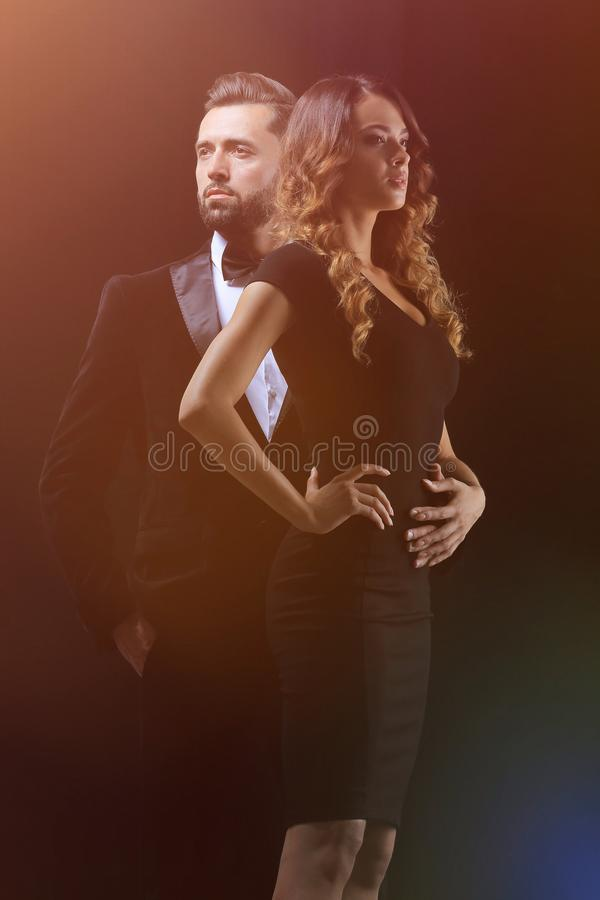 Hot girl in a black dress next to a businessman stock image