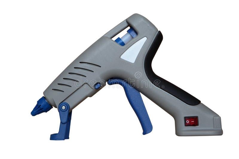 Hot glue gun. And glue to repair royalty free stock photos
