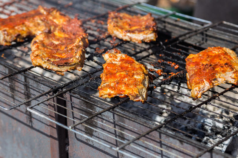 Hot grill ribs barbeque on lattice royalty free stock image