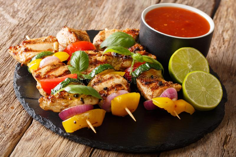 Hot grilled chicken kebab skewers with colorful vegetables with stock photos