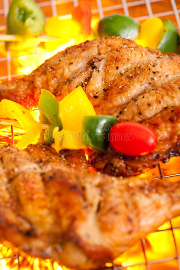 Grilled chicken. Hot grilled chicken with vegetable royalty free stock image