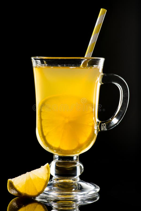 Hot grog with lemon and honey. On dark background royalty free stock image