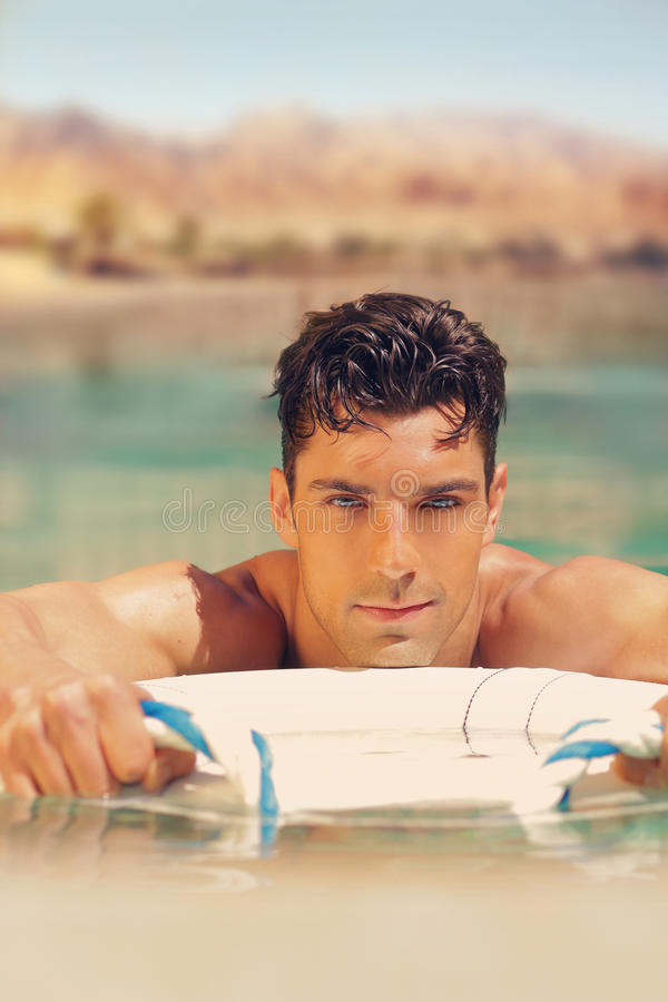 Hot guy in pool royalty free stock images