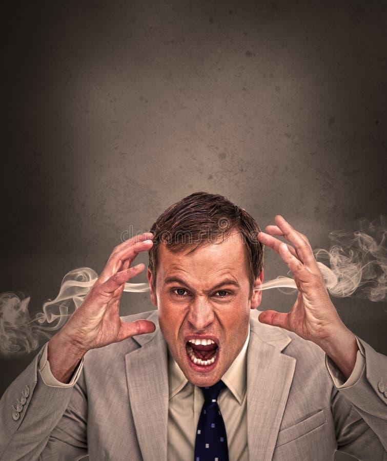 Hot headed business man yelling stock photos
