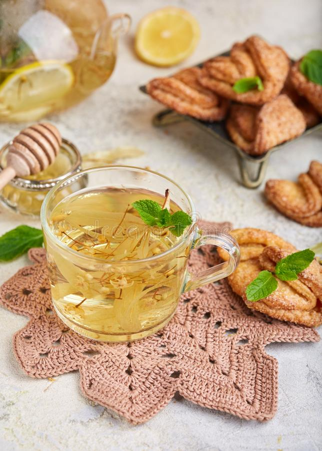 Hot herbal tea with linden flowers, lemon, honey and mint stock image