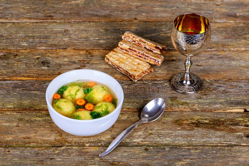 Hot Homemade Matzo Ball Soup in a Bowl Passover wine and matzah stock photography