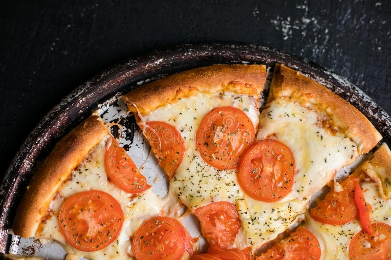 Hot homemade pizza ready to eat. Hot homemade pizza Margarita ready to eat royalty free stock images