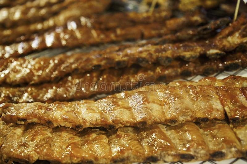 Hot juicy grilled pork ribs on the grill. Grilled meat. Tasty hot food. stock image