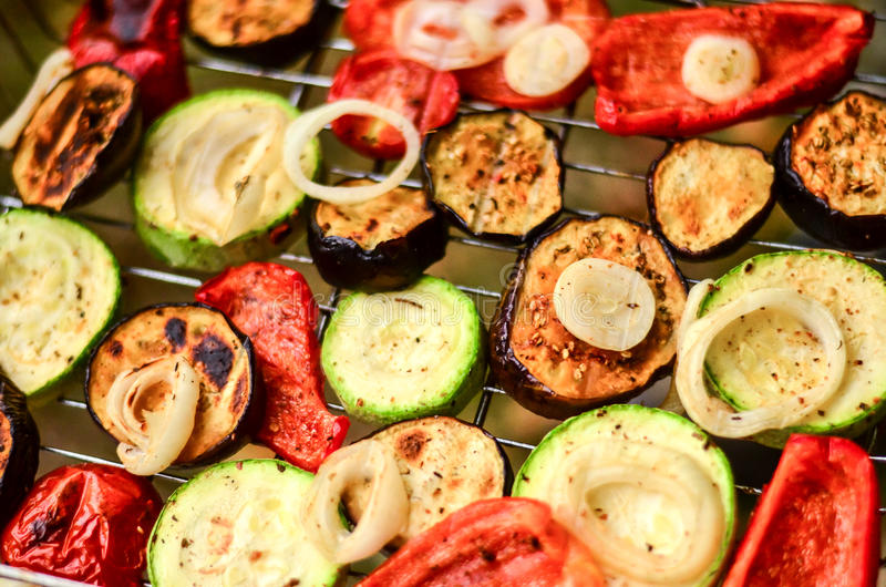 Hot, juicy vegetables on the grill grilled eggplant, zucchini, peppers royalty free stock photos