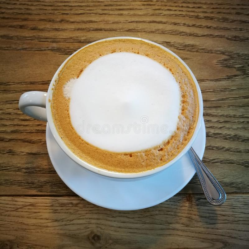 hot latte with milk stock image