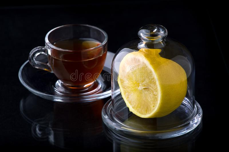 Half a lemon in a glass vase royalty free stock image