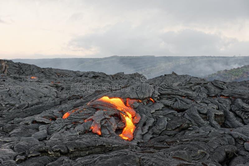 Liquid lava in morning light on Hawaii royalty free stock photography