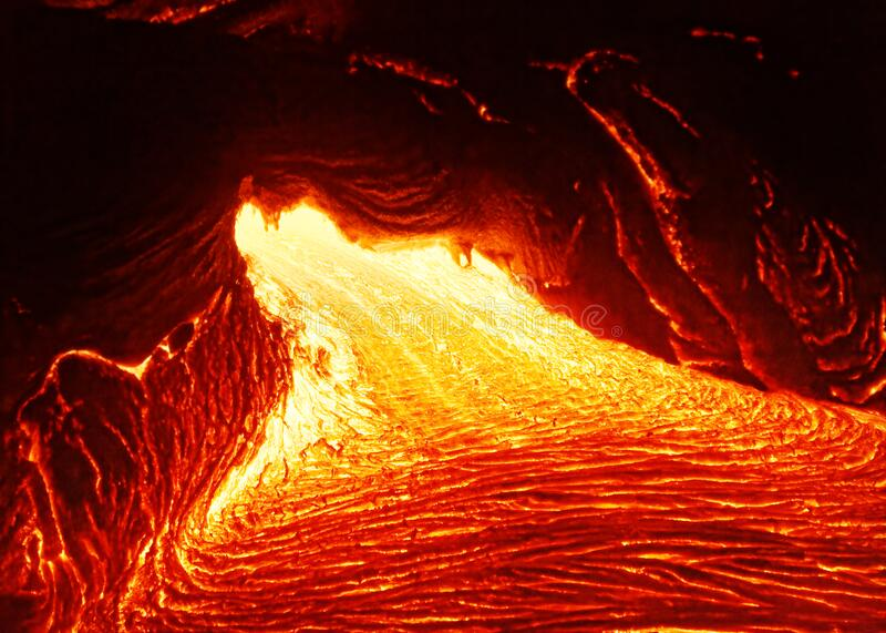 Hot magma emerges from a crack in the earth royalty free stock photography