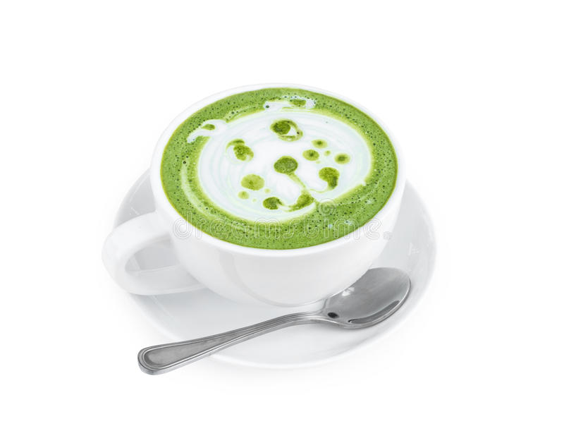Hot matcha latte art with cute dog face cartoon on glass table o royalty free stock photography