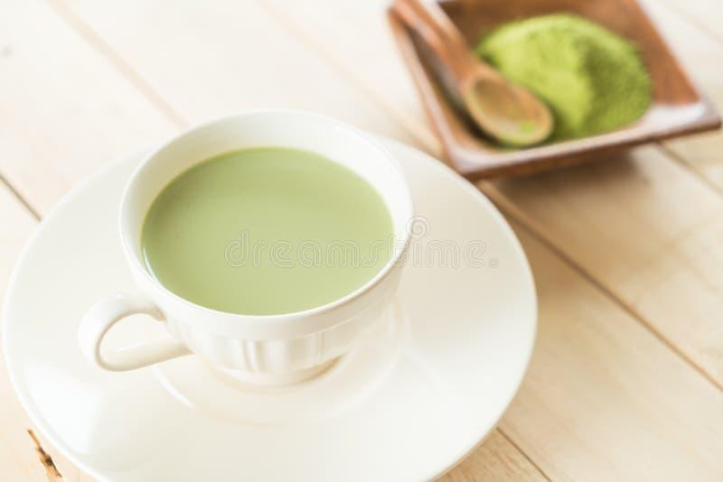 Hot matcha latte. On wood stock image