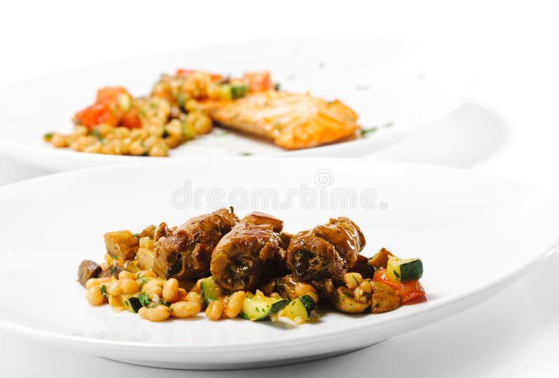 Hot Meat Dish - Beef Roll on Vegetable stock images