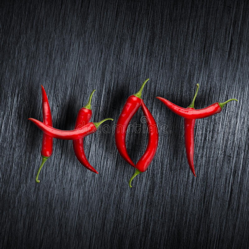 Hot message made of chili peppers stock images