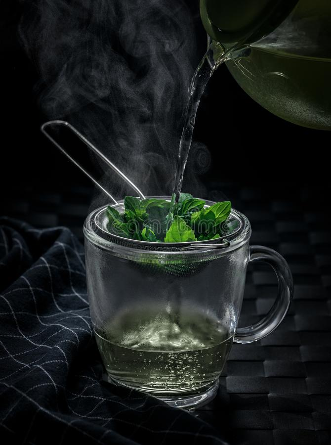 Hot mint tea in winter. Green tea herbal cup white tea with drinks flavonoids lemon mint hot steam warm winter health glass comfort greenery medicine nature royalty free stock photography