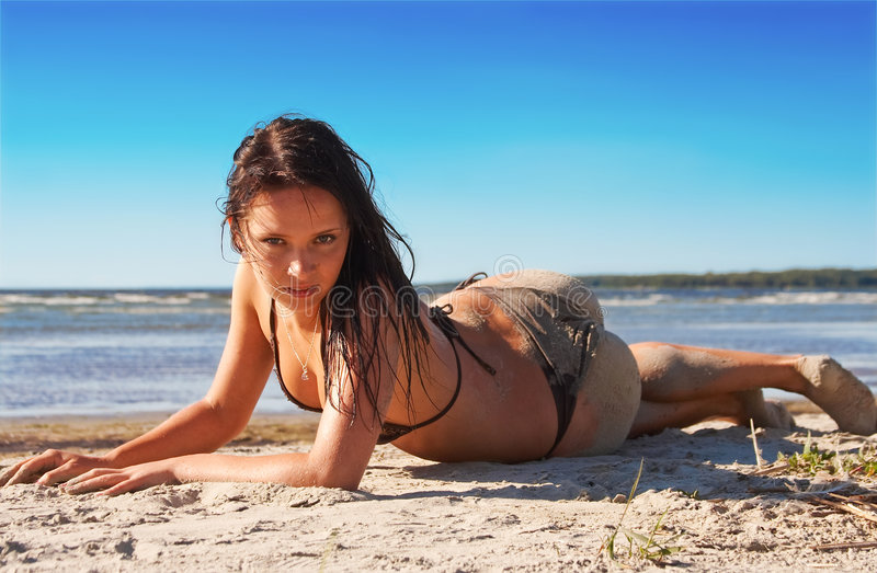 Hot model in bikini. With a sandy back royalty free stock photos