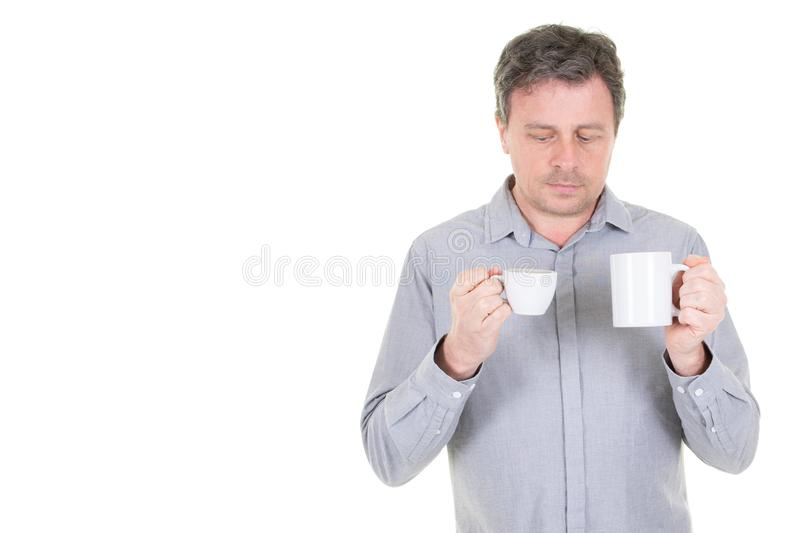 Hot mug coffee and cup of tea looking difference in white copy space background royalty free stock images