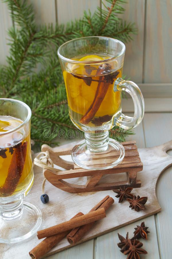 Hot mulled wine with Christmas spices and orange slices, anise and cinnamon sticks, vertical bright image royalty free stock photos