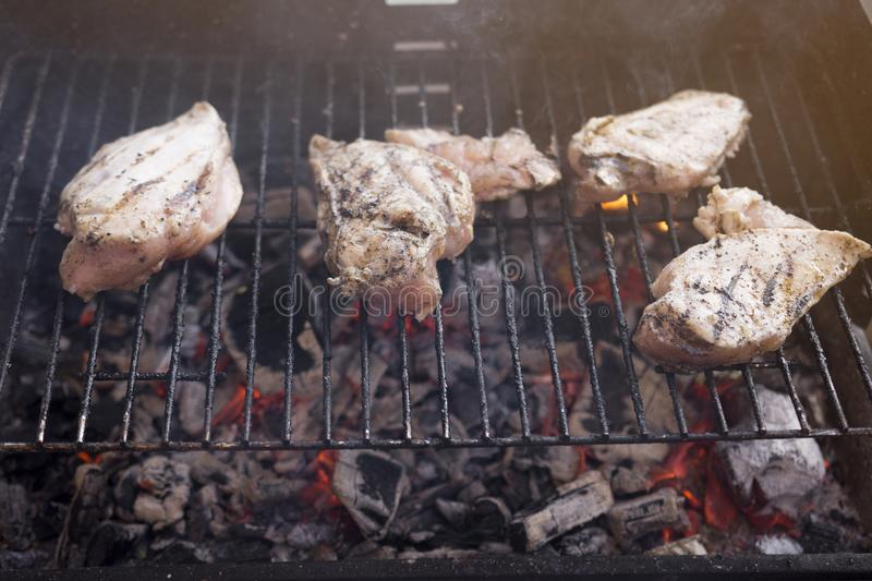 BBQ Grill With Tasty Chicken Breast Meat stock photos