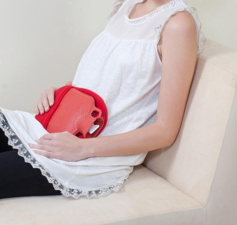 Hot pack for relieve the pain. If you have abdominal pain by menstruation, the hot pack can help you relieve the pain stock photography