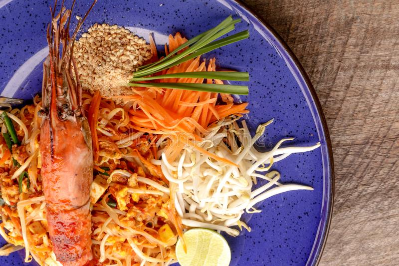 Hot Pad thai with shrimp on wooden table. Pad thai so deliciousclose up royalty free stock image